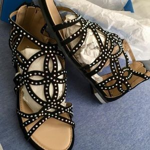 Black sandals with silver accents